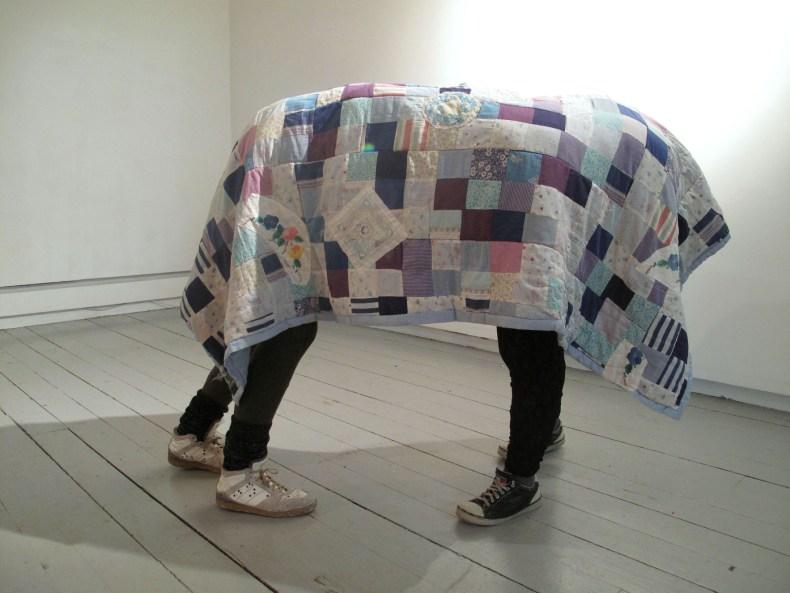 4-indoor-pursuits_sculpture-of-leg-casts-clothes-blanket_20105